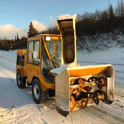 Snowline Alaska truck has state the art equipment to deal with any winter related challenge, including sanding and snow plowing